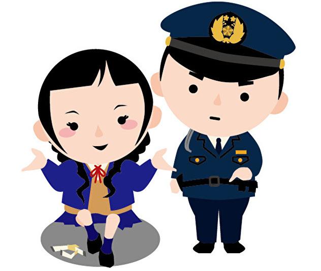 警察官に注意される女子高生